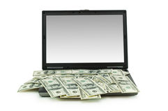 E-commerce concept. With dollars and laptop isolated on the white Stock Photo