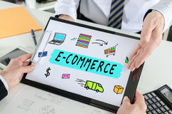 E-commerce concept on a clipboard. E-commerce concept shown by a businessman stock photo