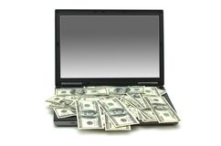 E-commerce concept with dollars. And laptop isolated on the white Stock Image