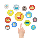 E-commerce concept. Female hand touching and pointing on e-commerce and financial icons. Isolated on white background Stock Images