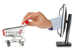 Computer monitor and hand with shopping cart Royalty Free Stock Image