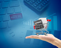 e-commerce concept. hand with a shopping cart Royalty Free Stock Photo