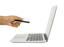 E-commerce concept image. a hand with credit card and notebook Royalty Free Stock Photos