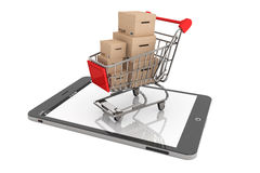 Shopping Cart with Boxes over Tablet PC Royalty Free Stock Photos