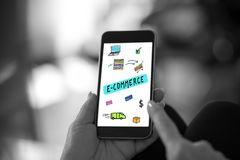 E-commerce concept on a smartphone. Hand holding a smartphone with e-commerce concept royalty free stock images