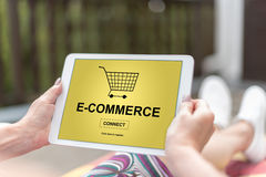 E-commerce concept on a tablet. Female hands holding a tablet with e-commerce concept stock photo