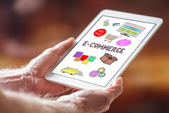 E-commerce concept on a tablet. Man holding a tablet showing e-commerce concept royalty free stock photography