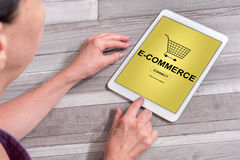 E-commerce concept on a tablet. Woman using a tablet showing e-commerce concept stock photo