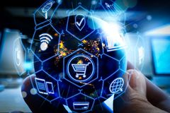 E-commerce concept with VR digital interface with icons of shopping cart and delivery truck and credit card with symbol of online. Purchase on internet.Earth at royalty free stock image