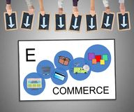 E-commerce concept on a whiteboard. Hands holding writing slates with arrows pointing on e-commerce concept stock images