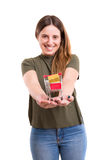 E-commerce concept. Young woman holding a small cart full of gifts - E-commerce concept stock images