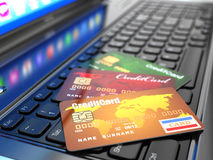 E-commerce. Credit card on laptop keyboard. Royalty Free Stock Images