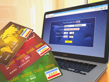E-commerce. Credit cards on laptop Royalty Free Stock Photo