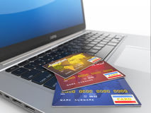 E-commerce. Credit cards on laptop Stock Photos