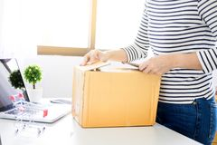 E-commerce delivery concept and online selling start up small bu. Siness owner packing in the card box at workplace. freelance woman seller prepare product for royalty free stock images