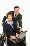 E-Commerce for Disabled. Disabled woman and her boss doing business over the internet.  Isolated on white Royalty Free Stock Photo