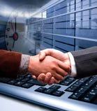 E-commerce handshake. Over blur background Stock Photo