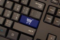 E-commerce key on keyboard. E-commerce blue key on keyboard stock photography