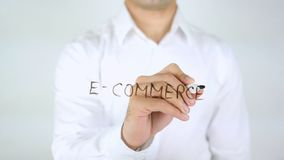 E-Commerce, Man Writing on Glass. High quality royalty free stock photo