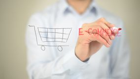E-Commerce, Man writing on transparent screen royalty free stock photos