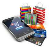 E-commerce. Online internet shopping. Mobile phone, shopping bag. S and credit cards.  3d Royalty Free Stock Images