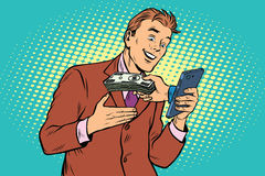 E-Commerce online payment, businessman and smartphone. Pop art retro vector illustration Stock Photo