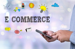 E COMMERCE. Person holding a smartphone on blurred cityscape background Royalty Free Stock Photo