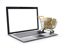 E-commerce. Shopping cart with cardboard boxes on laptop. Royalty Free Stock Photos