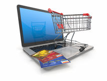 E-commerce. Shopping cart and credit cards on laptop Stock Photography