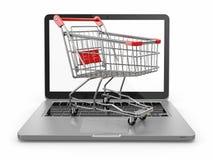 E-commerce. Shopping cart on laptop. Stock Photos