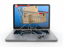 E-commerce. Shopping cart on laptop. Stock Photos