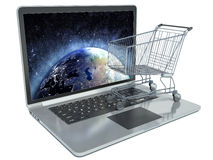 E-commerce. Shopping cart on laptop Royalty Free Stock Photos