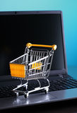 E-commerce shopping. Online shopping e-commerce shopping cart with notebook Stock Photo