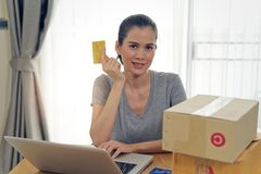 Asian beautiful girl buying online from website using credit card for payment. royalty free stock photography