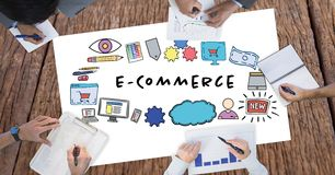 E-commerce text surrounded by graphics and business people`s hands. Digital composite of E-commerce text surrounded by graphics and business people`s hands Royalty Free Stock Photos