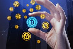 E-commerce and trade concept. Hand holding creative bitcoin hologram on abstract city background. E-commerce and trade concept. Double exposure royalty free stock photo