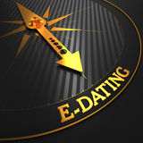 E-Dating on Golden Compass Needle. Stock Image