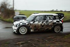 E.Donnelly que conduz Mini Cooper WRC Fotografia de Stock Royalty Free