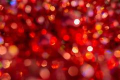 E Fondo rojo abstracto Defocused de la Navidad stock de ilustración