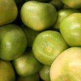 E Göra grön pomeloen Arkivfoto