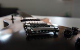 E-Gitarren-Schwarzes, musikalische Ausrüstung für Musik Lizenzfreies Stockfoto