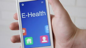 E-Health concept application on the smartphone. Man uses mobile app.