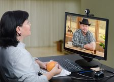 Man learning immunization technique with e-health support. E-health doctor teaches cowboy how to do disease immunization like flu. For explanation telemedicine royalty free stock photo