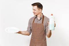 E Lavare i piatti con il liquido del pulitore in bottiglia immagine stock