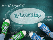 E-learning against green chalkboard Stock Photo
