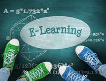 E-learning against green chalkboard Stock Photo