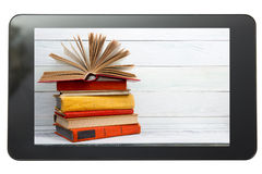 E-learning concept. Digital library - books inside. Tablet pc. Copy space for text Royalty Free Stock Photos