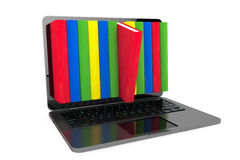 E-learning concept. Laptop with colorful books Stock Photos