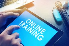 Online training on a screen of tablet. E-learning concept. Online training on a screen of tablet Stock Photo