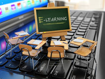 E-learning concept. Schooldesk and chalkboard on the laptop keyb Royalty Free Stock Photo